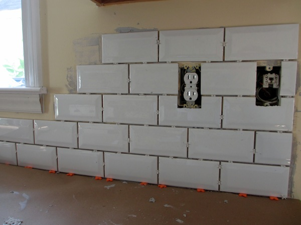 Putting tile in bathroom - Placed The Main Tiles First Primarily And Then Put The Trim Pieces