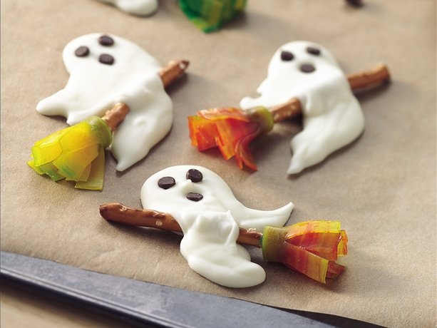 Halloween goodies ghosts on broomsticks